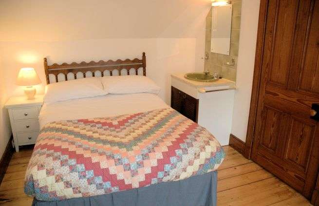 The second double bedroom in Tigharry Cottage is to the right off the landing at the top of the stairs. It is at the front of the cottage and has excellent sea and mountain views across Loch Carron.