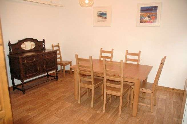Tigharry Cottage has a spacious and well-equipped kitchen and dining room. This room is at the rear of the property overlooking the back garden and is accessed via the second sitting room.