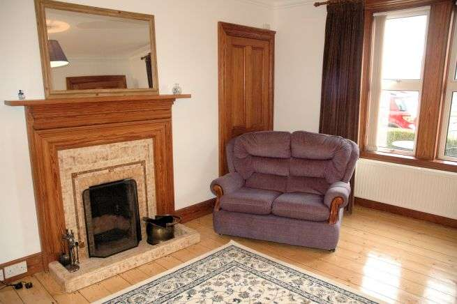 Tigharry Cottage has a comfortable and cosy sitting room. There is an open fire and excellent sea views across Loch Carron.