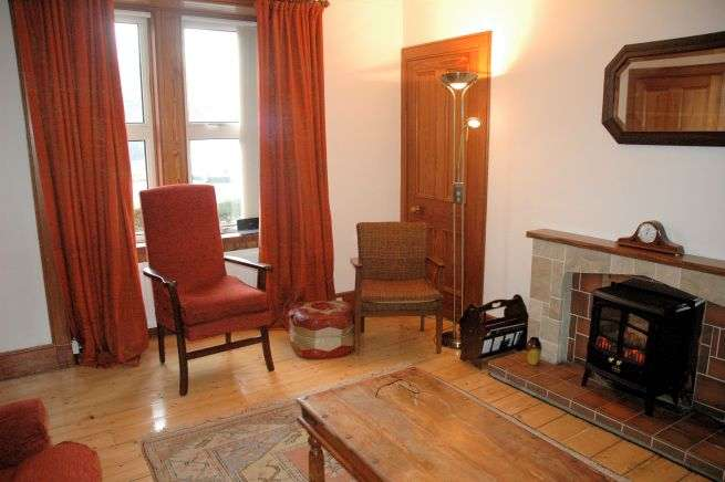 Tigharry Cottage has a comfortable and cosy sitting room. There is a fireplace with coal effect electric fire and excellent sea views across Loch Carron.
