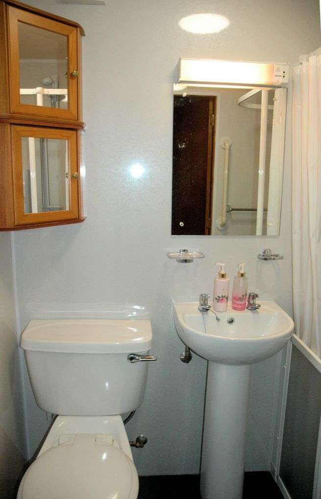 Tigharry Cottage has a shower room on the ground floor. This is reached via the Utility Room/Rear Lobby adjacent to the kitchen. The shower room is equipped as a partial wet room suitable for a disabled person and has a wash hand basin and WC.