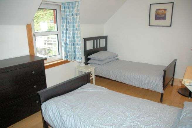 The twin bedroom in Tigharry Holiday Cottage is off the rear part of the landing at the back of the cottage. The main family bathroom is adjacent.